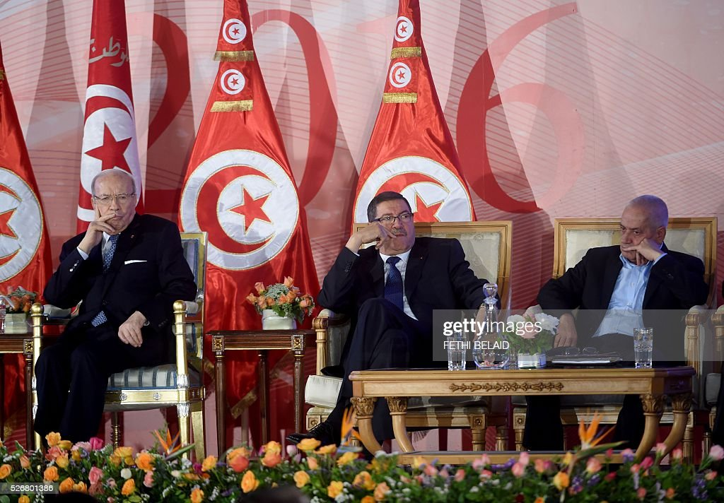 Tunisian President Beji Caid Essebsi (L) and prime minister Habib Essid (C) and the 2015 Nobel Peace Prize laureates of the Tunisian National Dialogue Quartet, the Secretary General of the Tunisian General Labour Union, Houcine Abbassi attend a May Day celebration on May 1, 2016 in the capital Tunis. / AFP / FETHI