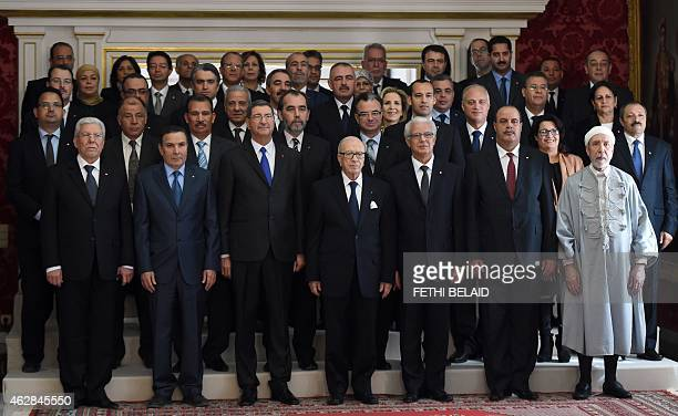 Tunisian President Beji Caid Essebsi flanked by Prime Minister Habib Essid and Justice Minister Mohamed Salah Ben Aissa poses for a family picture...