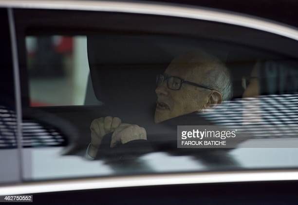 Tunisian President Beji Caid Essebsi leaves after a welcoming ceremony upon his arrival at HouariBoumediene international airport on February 4...