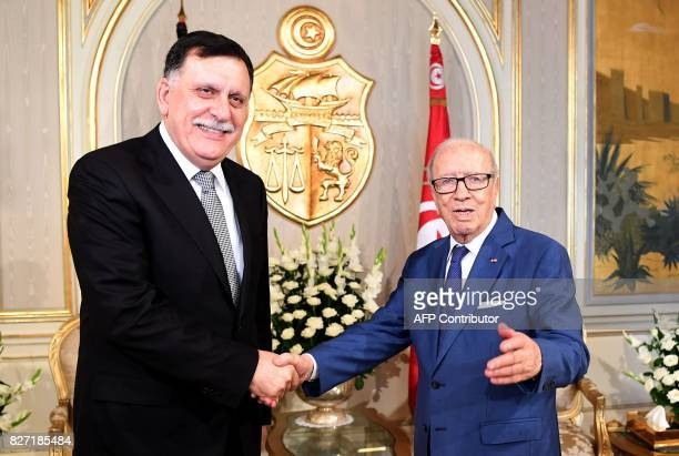 Tunisian President Beji Caid Essebsi meets with Libya's UNbacked Prime Minister Fayez alSarraj in Tunis on August 7 2017 / AFP PHOTO / FETHI BELAID
