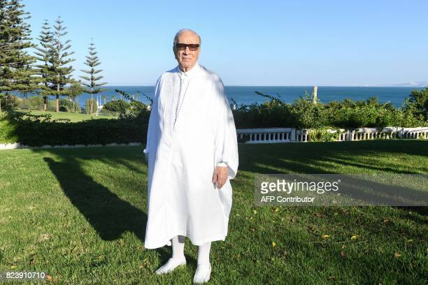 Tunisian President Beji Caid Essebsi poses for a picture in traditional costume at the official house of the Tunisian president in Carthage on July...