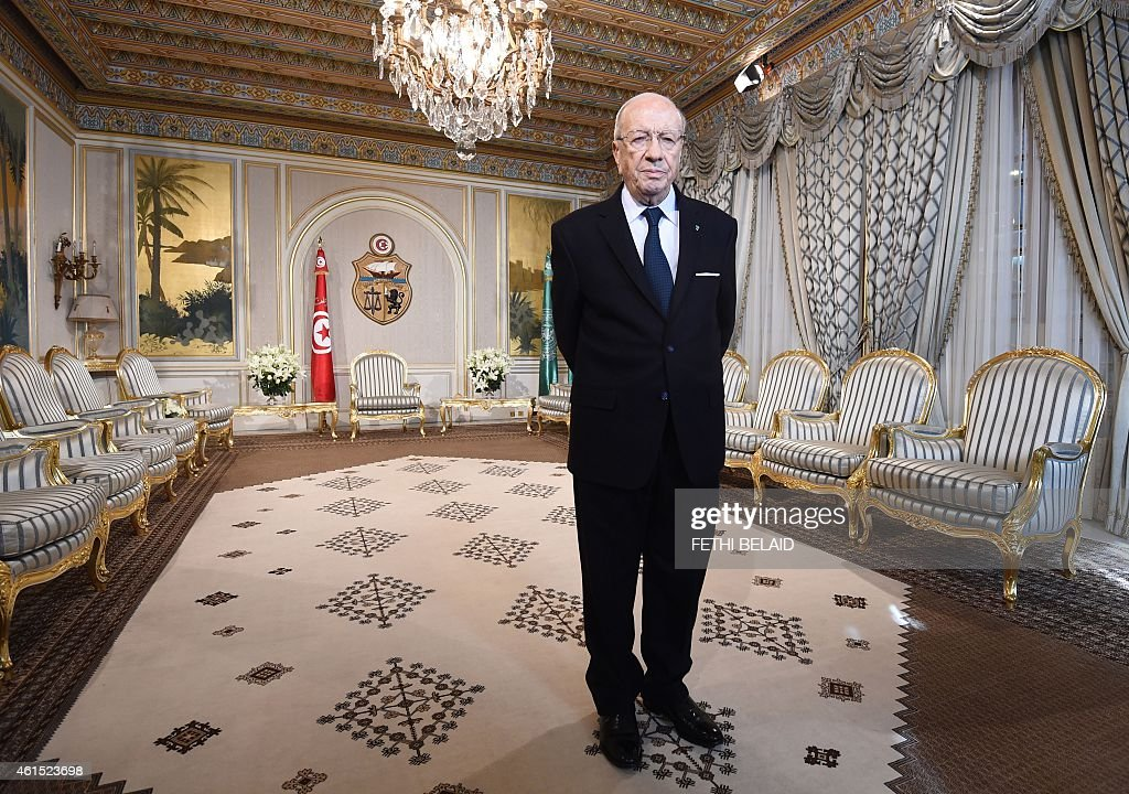 Tunisian President Beji Caid Essebsi stands in his office before an event in Tunis on January 14, 2015, marking the fourth anniversary of the ousting of Tunisia's longtime ruler Zine el Abidine Ben Ali, that sparked the Arab Spring uprisings. On January 14 2011, under massive popular pressure over unemployment and inflation, Ben Ali fled to Saudi Arabia with his family after 23 years in power. AFP PHOTO/ FETHI BELAID