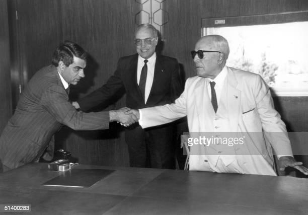 Tunisian President for Life Habib Ben Ali Bourguiba shakes hands in 1986 in Tunis with his Prime minister Zine ElAbidine Ben Ali Bourguiba ruled...