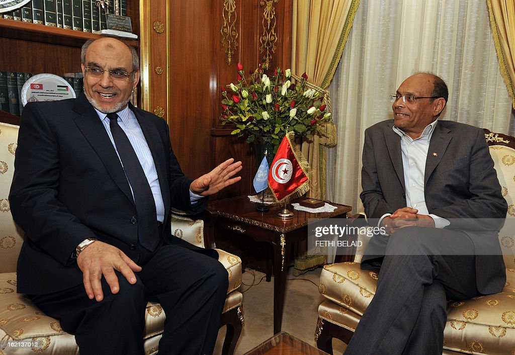 Tunisian President Moncef Marzouki (R) meets Prime Minister Hamadi Jebali on February 19, 2013, in Carthage palace in Tunis. Jebali is pursuing 'another solution' to Tunisia's biggest political crisis since the uprising two years ago after his plan to form a cabinet of technocrats failed.