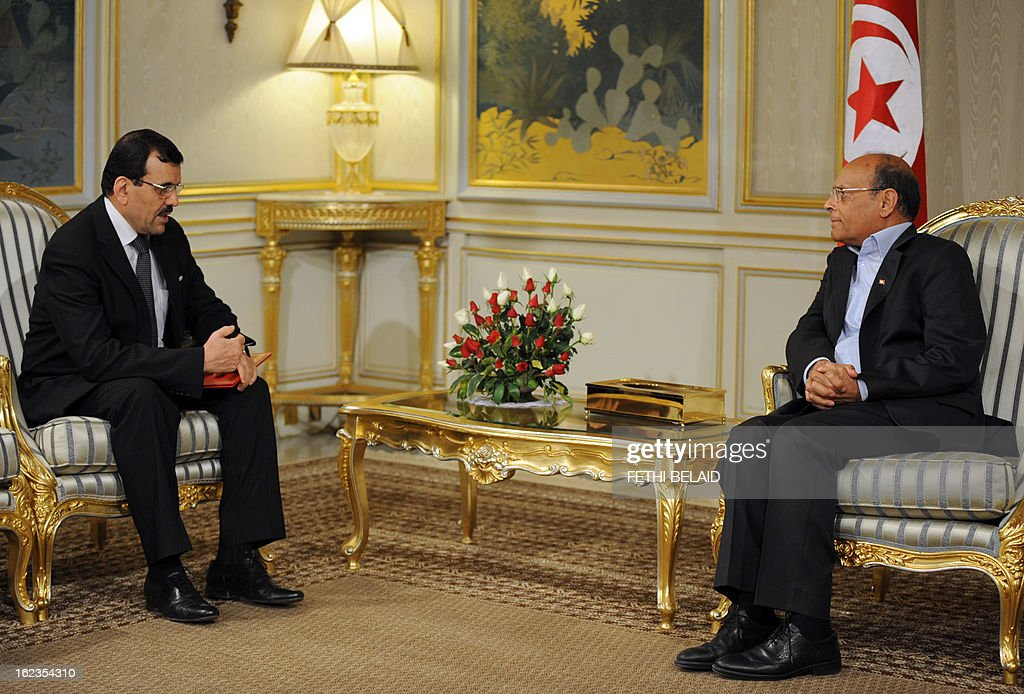 Tunisian President Moncef Marzouki (R) meets with Tunisian prime minister designate Ali Larayedh on February 22, 2013, in Tunis. Larayedh, the Islamist interior minister tapped to become Tunisia's next premier, pledged to form a cabinet representing all Tunisian men and women and upholding gender equality.