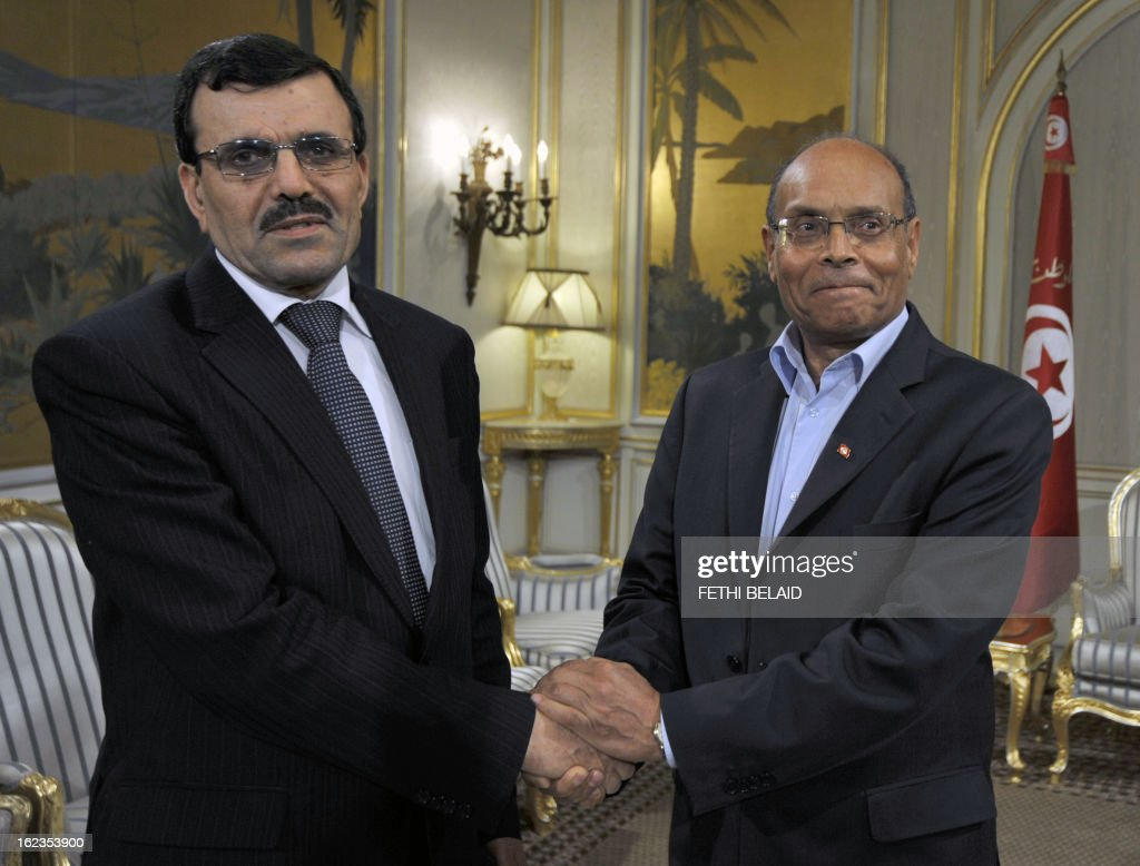 Tunisian President Moncef Marzouki (R) shakes hands with Tunisian prime minister designate Ali Larayedh on February 22, 2013, in Tunis. Larayedh, the Islamist interior minister tapped to become Tunisia's next premier, pledged to form a cabinet representing all Tunisian men and women and upholding gender equality.