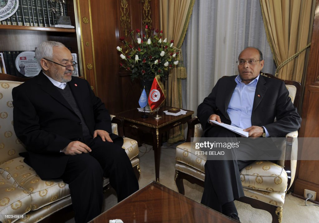 Tunisian President Moncef Marzouki talks with Ennahda ruling party's leader Rached Ghannouchi (L) before a meeting at the party's headquarters on February 22, 2013 in Tunis. Marzouki tasked Interior Minister Ali Larayedh with forming a new government after Prime Minister Hamadi Jebali resigned amid a major political crisis. AFP PHOTO / FETHI BELAID