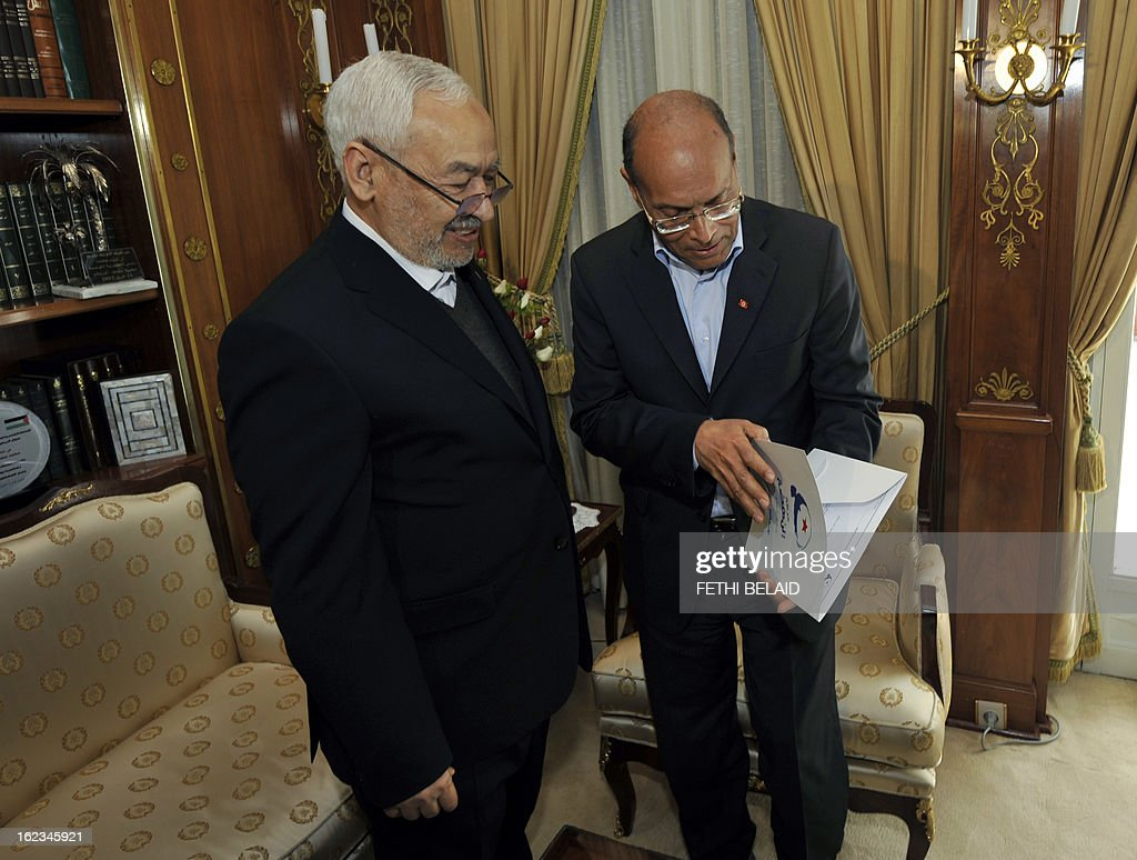 Tunisian President Moncef Marzouki talks with Ennahda ruling party's leader Rached Ghannouchi (L) to present Ennahda's candidate as Jebali's successor during a meeting at the party's headquarters on February 22, 2013 in Tunis. Marzouki tasked Interior Minister Ali Larayedh, who was put forward by Ennahda, with forming a new government after Prime Minister Hamadi Jebali resigned amid a major political crisis. AFP PHOTO / FETHI BELAID