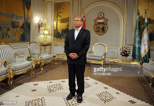 Tunisian President Moncef Marzouki waits in his office before receiving Tunisia's Islamist premier Ali Larayedh to submit his resignation on January...
