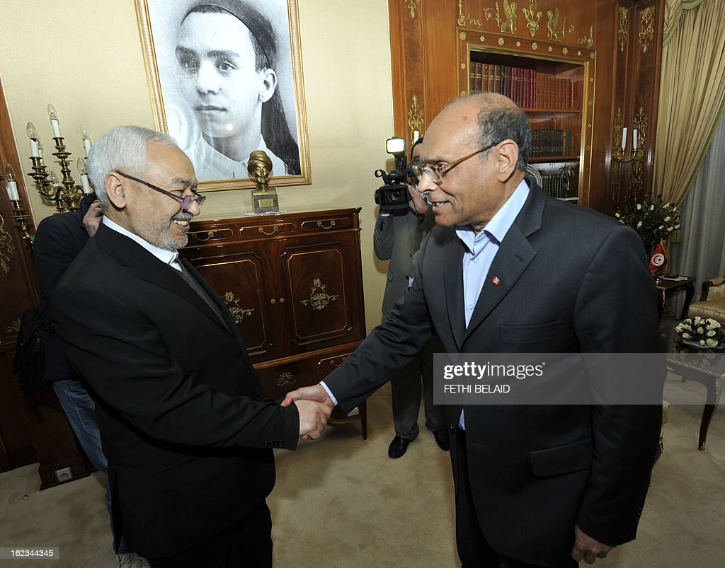 Tunisian President Moncef Marzouki welcomes Ennahda ruling party's leader Rached Ghannouchi (L) before a meeting at the party's headquarters on February 22, 2013 in Tunis. Marzouki tasked Interior Minister Ali Larayedh, who was put forward by Ennahda, with forming a new government after Prime Minister Hamadi Jebali resigned amid a major political crisis.