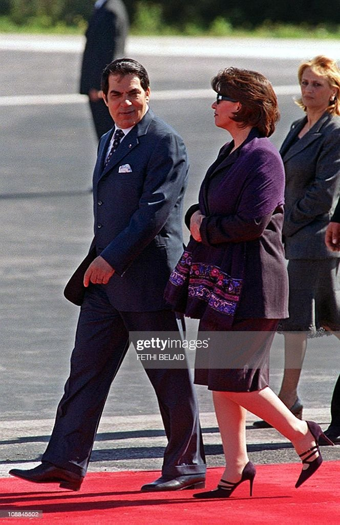 Tunisian President Zine El-Abidine Ben Ali and his wife <a gi-track='captionPersonalityLinkClicked' href=/galleries/search?phrase=Leila+Ben+Ali&family=editorial&specificpeople=3198746 ng-click='$event.stopPropagation()'>Leila Ben Ali</a> (C) pictured 26 February 2002 at Tunis airport.