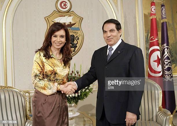 Tunisian president Zine ElAbidine Ben Ali greets his Argentinian counterpart Cristina Kirchner at Carthage palace on November 18 2008 near Tunis...