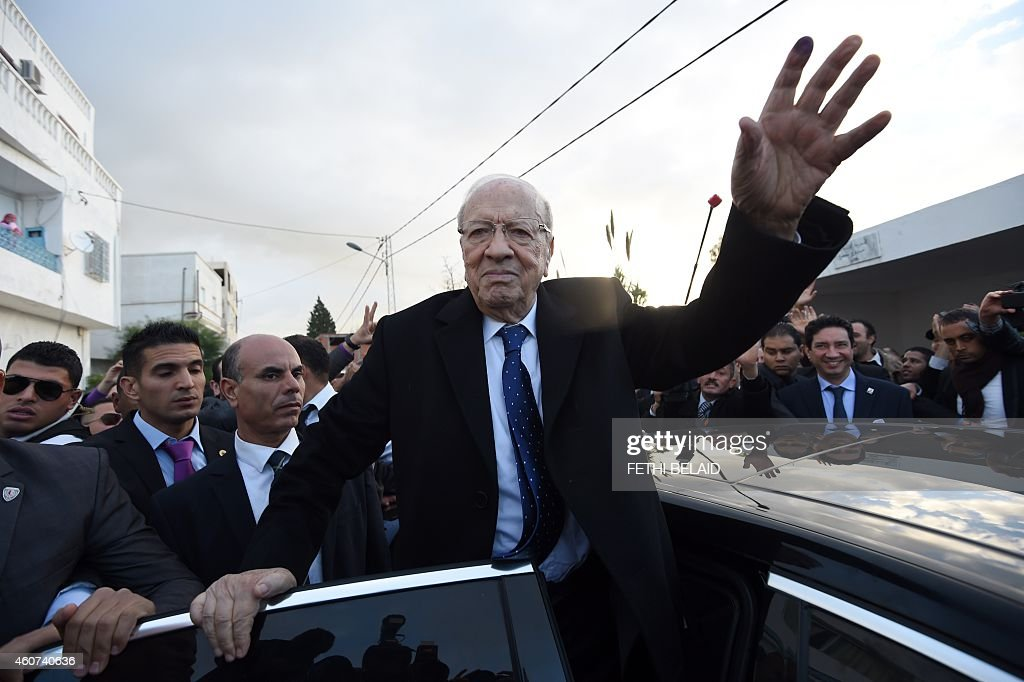 Tunisian presidential candidate for the anti-Islamist Nidaa Tounes party, <a gi-track='captionPersonalityLinkClicked' href=/galleries/search?phrase=Beji+Caid+Essebsi&family=editorial&specificpeople=998512 ng-click='$event.stopPropagation()'>Beji Caid Essebsi</a> reacts after placing his vote on December 21, 2014 in Tunis. The second round vote pits 88-year-old favourite <a gi-track='captionPersonalityLinkClicked' href=/galleries/search?phrase=Beji+Caid+Essebsi&family=editorial&specificpeople=998512 ng-click='$event.stopPropagation()'>Beji Caid Essebsi</a>, leader of the anti-Islamist Nidaa Tounes party, against incumbent Moncef Marzouki, who held the post through an alliance with the moderate Islamist movement Ennahda. AFP PHOTO / FETHI BELAID