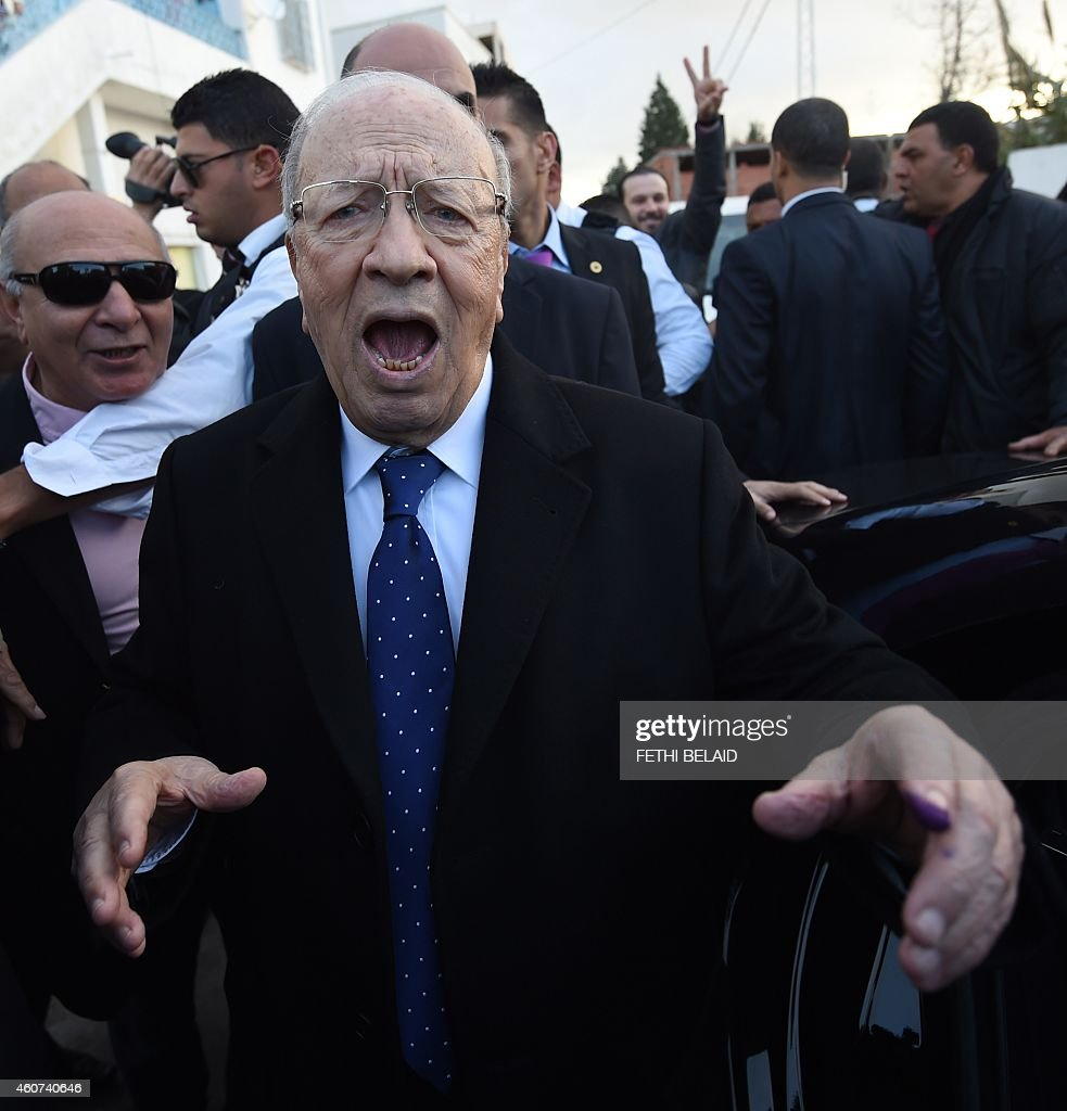 Tunisian presidential candidate for the anti-Islamist Nidaa Tounes party, <a gi-track='captionPersonalityLinkClicked' href=/galleries/search?phrase=Beji+Caid+Essebsi&family=editorial&specificpeople=998512 ng-click='$event.stopPropagation()'>Beji Caid Essebsi</a> reacts after placing his vote on December 21, 2014 in Tunis. The second round vote pits 88-year-old favourite <a gi-track='captionPersonalityLinkClicked' href=/galleries/search?phrase=Beji+Caid+Essebsi&family=editorial&specificpeople=998512 ng-click='$event.stopPropagation()'>Beji Caid Essebsi</a>, leader of the anti-Islamist Nidaa Tounes party, against incumbent Moncef Marzouki, who held the post through an alliance with the moderate Islamist movement Ennahda.