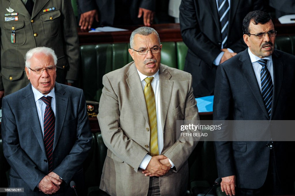 Tunisian Prime Minister Ali Larayedh (R), his advisor Noureddine Bhiri (C) and the Tunisian Defence Minister Rachid Sabbagh (L) attend a parliament session at the Constituent Assembly on May 8, 2013 in Tunis on the security situation in Kasserine, the regional capital of the western region of Mount Chaambi, as soldiers continue their hunt for a jihadist group hiding out in the border region with Algeria. Larayedh insisted that Tunisia's security situation was improving and that fugitive jihadist groups with links to Al-Qaeda would be defeated. AFP PHOTO / FETHI BELAID