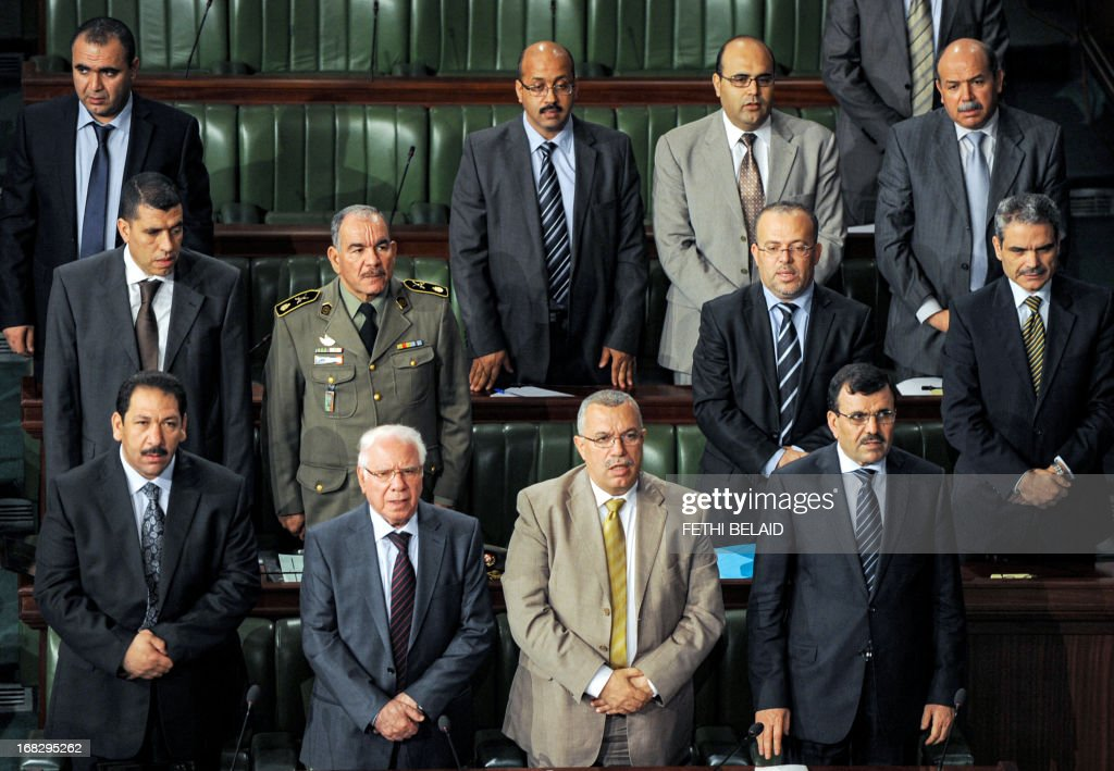 Tunisian Prime Minister Ali Larayedh (bottom-R), his advisor Noureddine Bhiri (bottom-2R) and the Tunisian Defence Minister Rachid Sabbagh (bottom-2L) attend a parliament session at the Constituent Assembly on May 8, 2013 in Tunis on the security situation in Kasserine, the regional capital of the western region of Mount Chaambi, as soldiers continue their hunt for a jihadist group hiding out in the border region with Algeria. Larayedh insisted that Tunisia's security situation was improving and that fugitive jihadist groups with links to Al-Qaeda would be defeated.