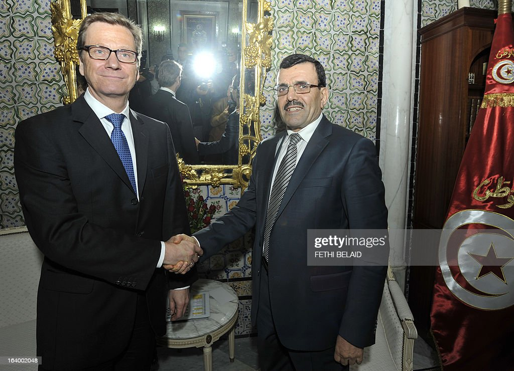 Tunisian Prime Minister Ali Larayedh (R) shakeshands with Germany's Foreign Affairs Minister Guido Westerwelle on March 19, 2013, in Tunis. Westerwelle is on a day official visit to Tunisia. AFP PHOTO / FETHI BELAID