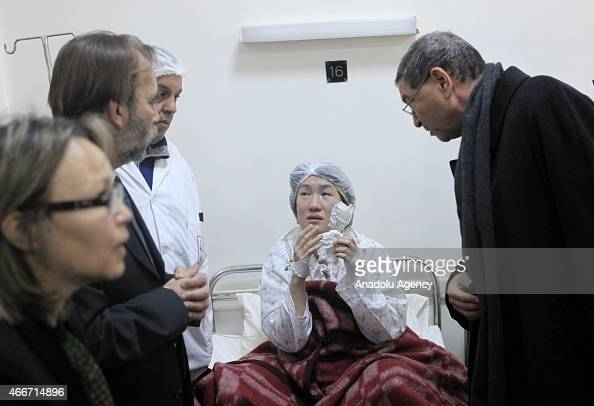 Tunisian Prime Minister Habib Essid and Tunisian Minister of Health Said Aidi visit a wounded woman after the terrorist attack on Bardo Museum in...