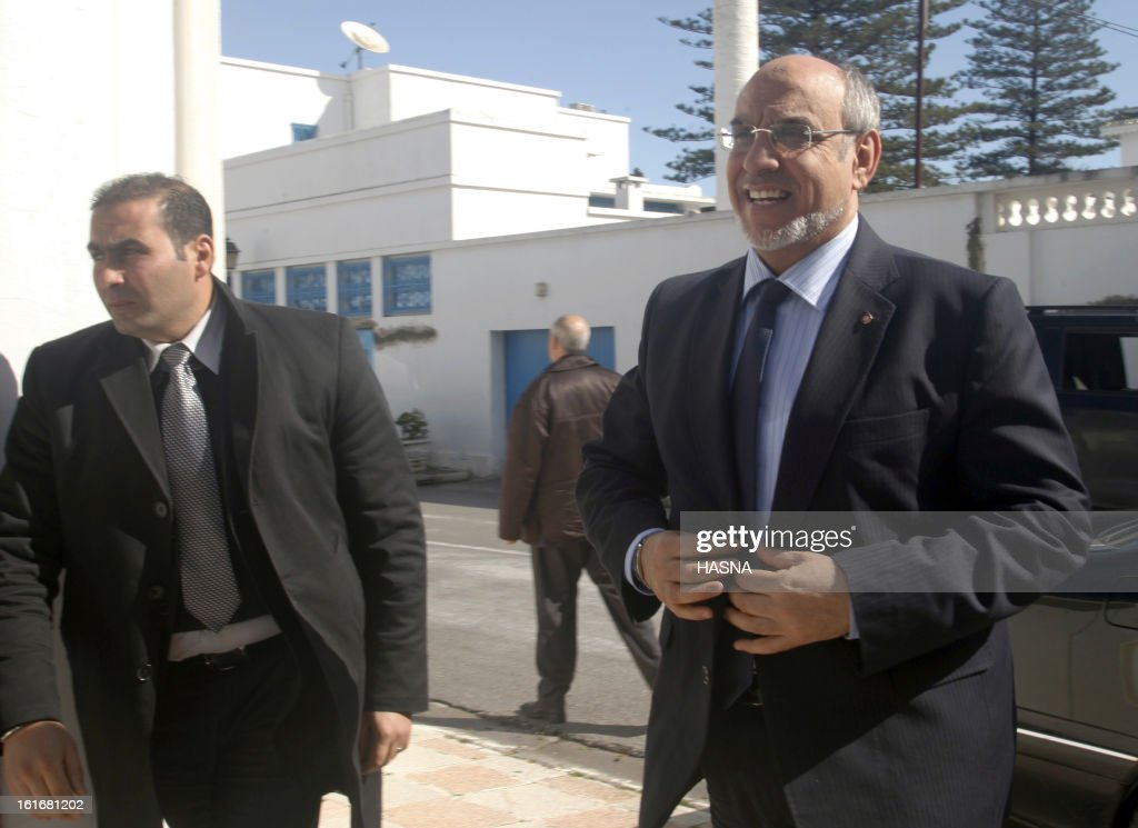 Tunisian Prime Minister Hamadi Jebali (R) arrives for a meeting with representatives of the Republican Party, part of his quest to form a government of technocrats and steer the country out of crisis, on February 14, 2013 in Tunis. Jebali has been seeking political support for his plan, after the assassination last week of a leftist opposition figure threw Tunisia into turmoil, as he has been facing stiff resistance from ruling party Ennahda.
