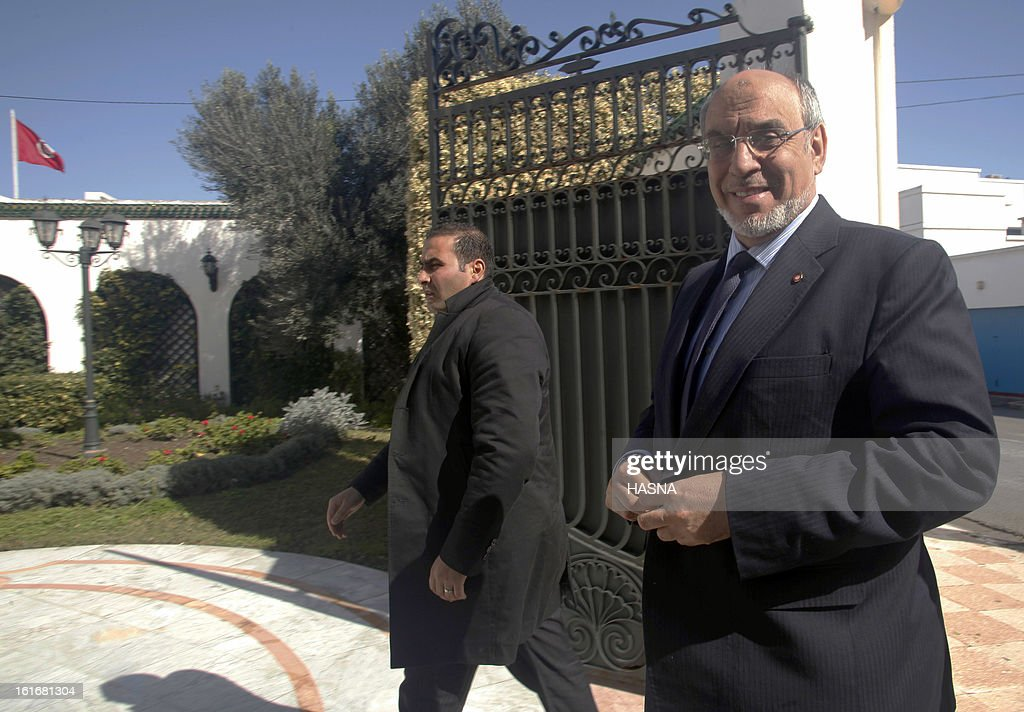 Tunisian Prime Minister Hamadi Jebali (R) arrives for a meeting with representatives of the Progressist democratic party's (PDP), part of his quest to form a government of technocrats and steer the country out of crisis, on February 14, 2013 in Tunis. Jebali has been seeking political support for his plan, after the assassination last week of a leftist opposition figure threw Tunisia into turmoil, as he has been facing stiff resistance from ruling party Ennahda. AFP PHOTO / HASNA