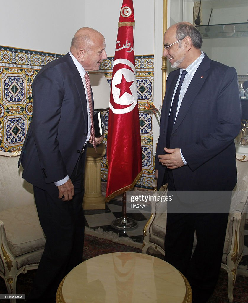 Tunisian Prime Minister Hamadi Jebali (R) is welcomed by the leader of the Progressist democratic party's (PDP) Nejib Chebbi before a meeting, part of Jebali's quest to form a government of technocrats and steer the country out of crisis, on February 14, 2013 in Tunis. Jebali has been seeking political support for his plan, after the assassination last week of a leftist opposition figure threw Tunisia into turmoil, as he has been facing stiff resistance from ruling party Ennahda. AFP PHOTO / HASNA