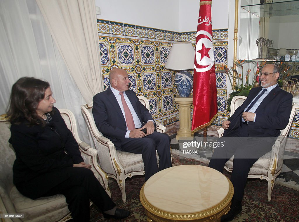 Tunisian Prime Minister Hamadi Jebali (R) talks with the leader of the Progressist democratic party's (PDP) Nejib Chebbi (C) and general secretary Maya Jeribi during a meeting, part of Jebali's quest to form a government of technocrats and steer the country out of crisis, on February 14, 2013 in Tunis. Jebali has been seeking political support for his plan, after the assassination last week of a leftist opposition figure threw Tunisia into turmoil, as he has been facing stiff resistance from ruling party Ennahda. AFP PHOTO / HASNA