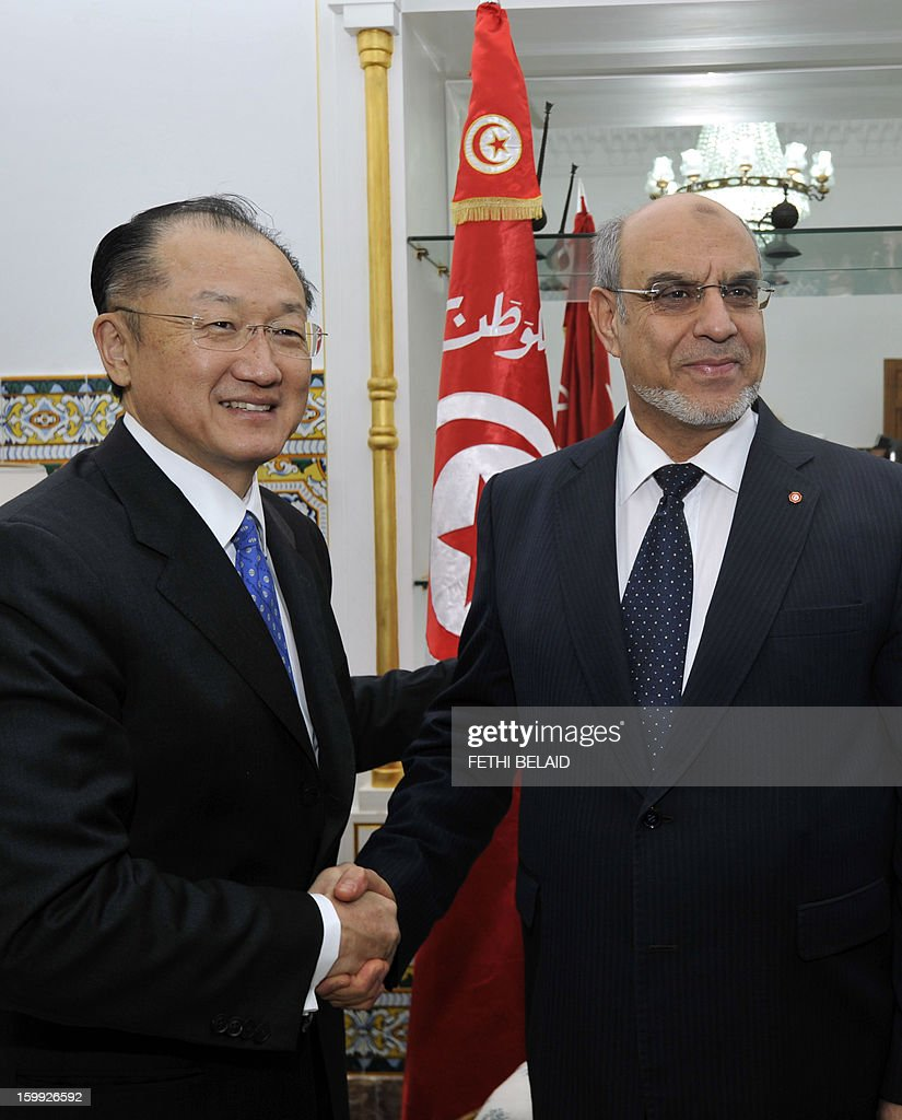 Tunisian Prime Minister Hamadi Jebali (R) welcomes the President of the World Bank Jim Yong Kim (L) on January 23, 2013 in Tunis. Kim is on 2 day official visit to Tunisia to discuss boosting economic growth.