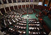 Tunisian Prime Minister Mehdi Jomaa delivers a speech on December 10 2014 in parliament in Tunis on the state budget as a draft finance act for 2015...