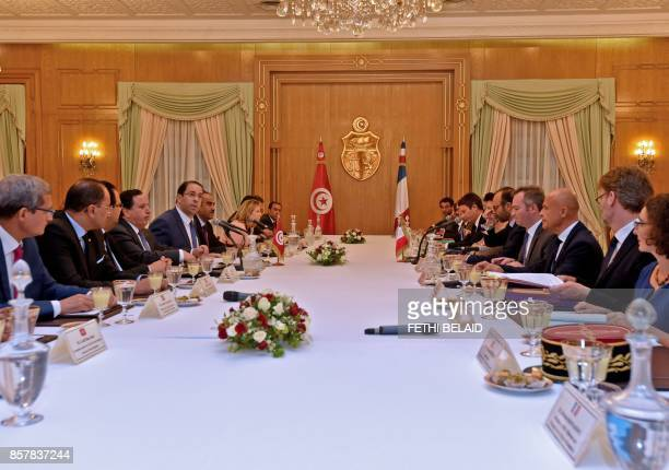Tunisian Prime Minister Youssef Chahed and French Prime Minister Edouard Philippe attend a meeting on October 5 2017 in Tunis Philippe in on one day...