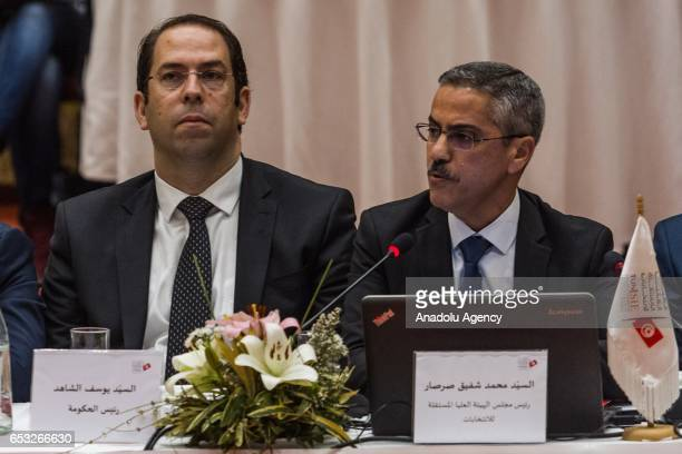 Tunisian Prime Minister Youssef Chahed and ISIE President Chafik Sarsar take part in a press conference held by the Independent High Authority for...