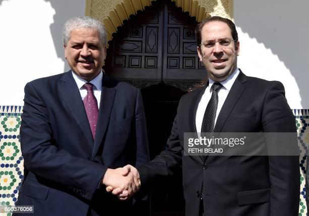 Tunisian Prime Minister Youssef Chahed greets his Algerian counterpart Abdelmalek Sellal on March 9 2017 in Tunis Algerian President Abdelaziz...