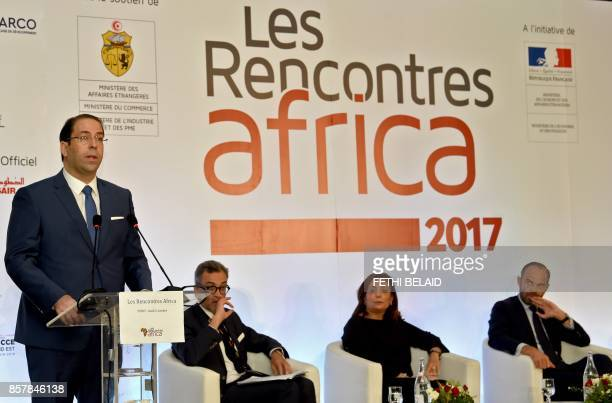 Tunisian Prime Minister Youssef Chahed speaks as his French counterpart Edouard Philippe and Utica President and former Nobel prize winner Wided...