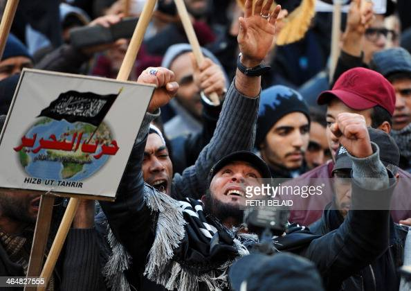 Tunisian protesters shoot slogans during a demonstration called by the supporters of radical Islamist party Hizb utTahrir to protest against the...