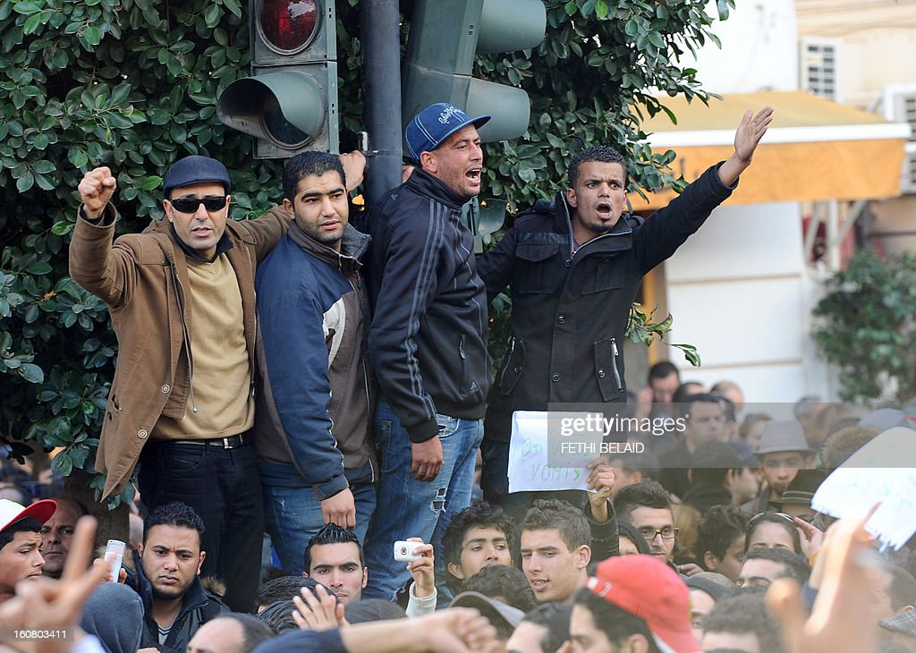 Tunisian protesters shout slogans during a rallye outside the Interior ministry to protest after Tunisian opposition leader and outspoken government critic Chokri Belaid was shot dead with three bullets fired from close range, on February 6, 2013 in Tunis. The protesters, who massed on Habib Bourguiba Avenue, epicentre of the 2011 uprising that ousted ex-dictator Zine El Abidine Ben Ali, pelted the police with bottles and the police responded by firing tear gas, chasing the protesters and beating them with batons.