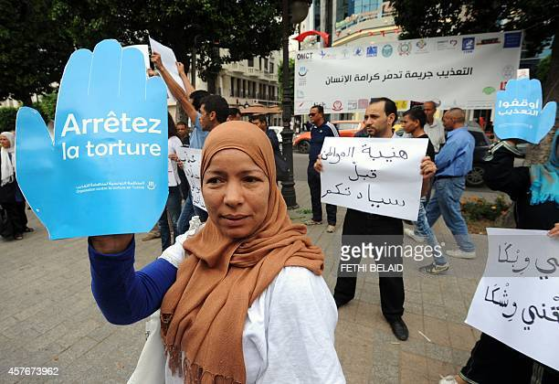 Tunisian protesters who have had family members that were victims of torture by members of the Tunisian security forces and authorities shout slogans...