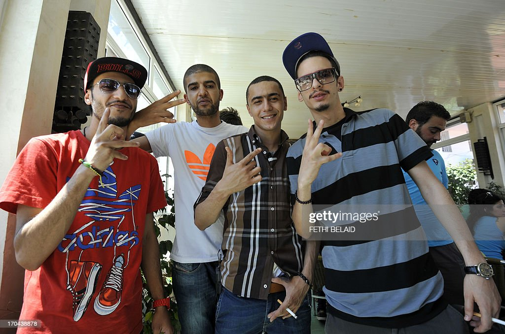 Tunisian rapper Ala Yaacoubi, better know by his rap name 'Weld El 15 (2nd R), arrives for his trial alongside Tunisian rappers Spoiled Boy (L), Madou MC (2nd L) and Emino (R) at the court in the Tunis suburb of Ben Arous on June 13, 2013. The Tunisian rapper risks up to seven years in prison for insulting the police has said he was 'afraid' ahead of his trial and criticised the authorities for not respecting freedom of expression.
