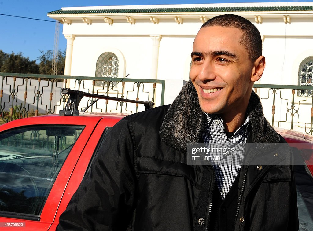 Tunisian rapper Ala Yaacoubi, better known by his rap name 'Weld El 15, arrives at the courthouse for his appeal trial on December 5, 2013 in the Hammamet suburb of Nabeul. Weld El 15 has been on the run since August when he received a 21-month jail sentence, on separate charges of performing songs deemed insulting to the police. He appeals the verdict after a fellow rapper (who was convicted on the same charges) was released on appeal in September after contesting the ruling.