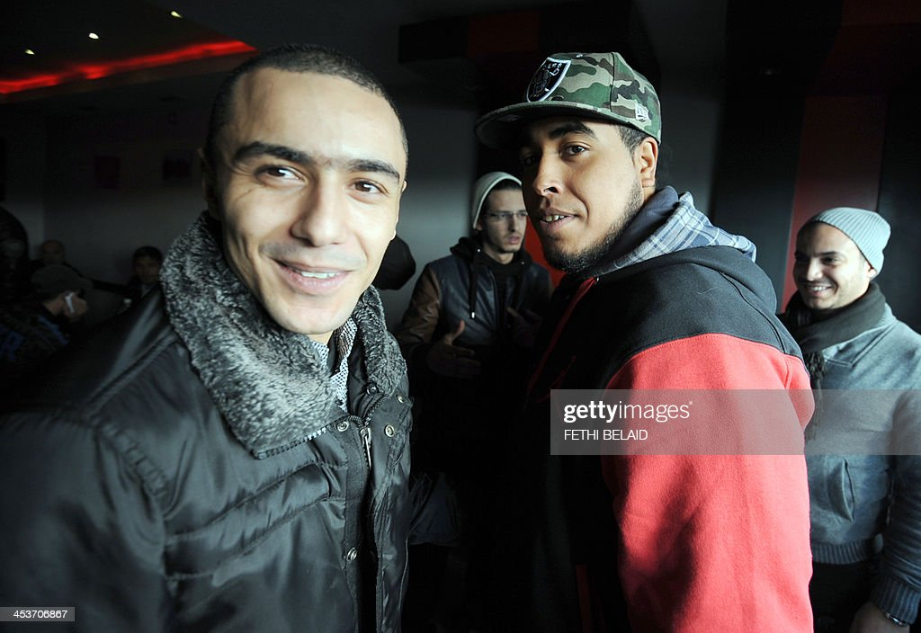 Tunisian rapper Ala Yaacoubi, better known by his rap name 'Weld El 15 poses with rapper Ahmed Ben Ahmed (R) (aka Klay BBJ) upon his arrival at the courthouse for his appeal trial on December 5, 2013 in the Hammamet suburb of Nabeul. Weld El 15 has been on the run since August when he received a 21-month jail sentence, on separate charges of performing songs deemed insulting to the police. He appeals the verdict after Klay BBJ (who was convicted on the same charges) was released on appeal in September after contesting the ruling.