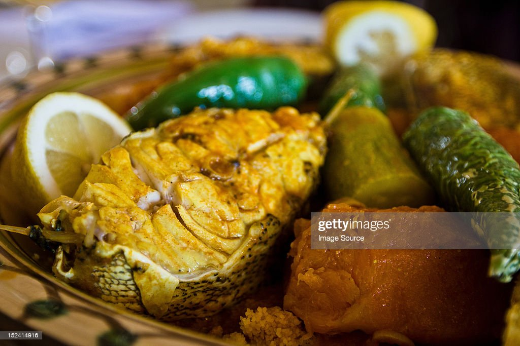 Tunisian restaurant dish of grouper with vegetables, Djerba : Stock Photo