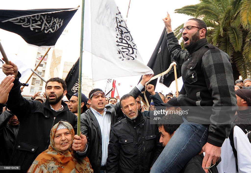 Tunisian Salafists shout slogans during a demonstration outside the National Constituent Assembly in Tunis to demand the application of the Islamic sharia law on January 11, 2013.