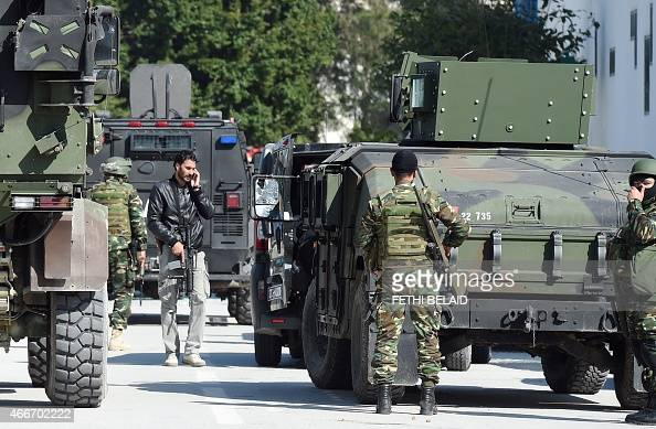 Tunisian security forces and military personnel secure the area after gunmen attacked Tunis' famed Bardo Museum on March 18 2015 At least seven...