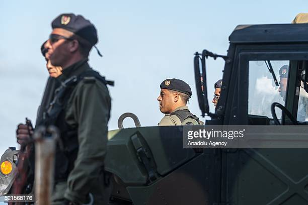 Tunisian security forces guard after the clashes between a group of demonstrators protesting against oil tankers try to reach Petrofac Oil company's...