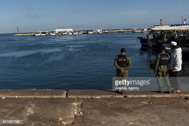 Tunisian security forces guard in the seaside after the clashes between a group of demonstrators protesting against oil tankers try to reach Petrofac...