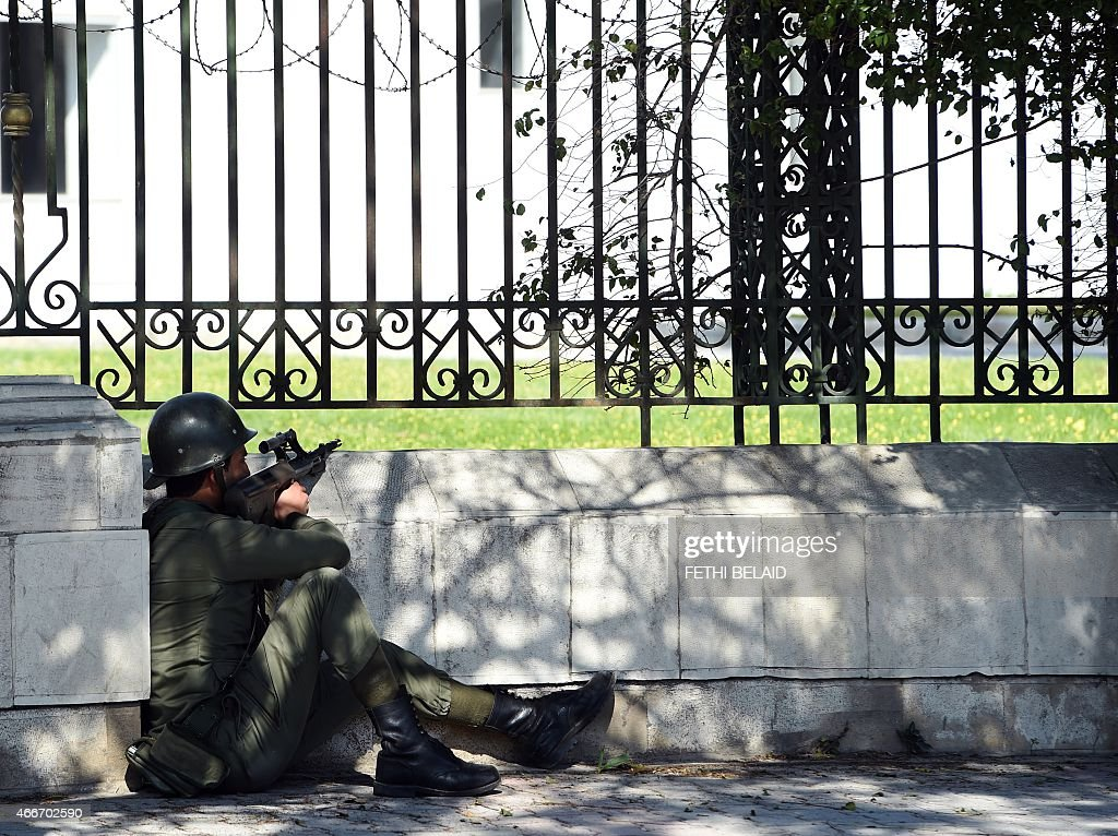 Tunisian security forces secure the area after gunmen attacked Tunis' famed Bardo Museum on March 18 2015 At least 17 foreigners were killed they...