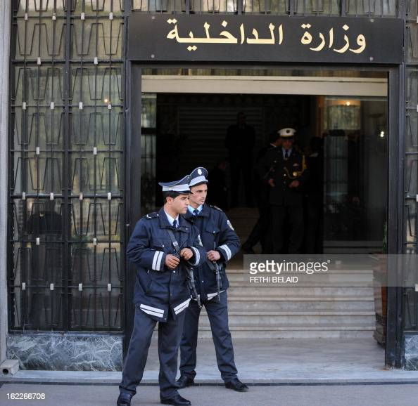 Tunisian security forces stand guard in front of the Interior Ministry headquarters in Tunis on February 21 as the minister met with the outgoing...