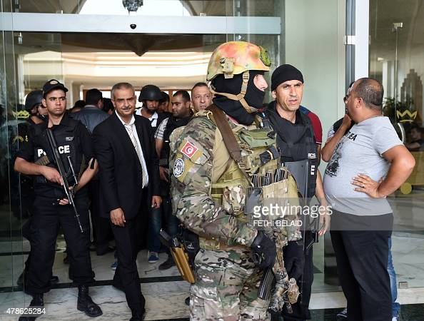 Tunisian security forces stand in front of the Imperial hotel in the resort town of Sousse a popular tourist destination 140 kilometres south of the...