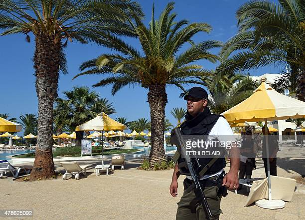 A Tunisian security member stands next to a swimming pool at the resort town of Sousse a popular tourist destination 140 kilometres south of the...