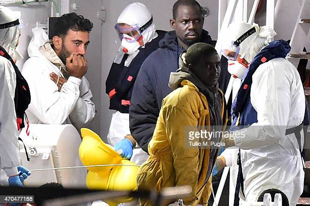 Tunisian skipper Mohammed Ali Malek stands on the deck of the Italian Coast Guard ship Gregretti which is carrying 27 survivors of the migrant...
