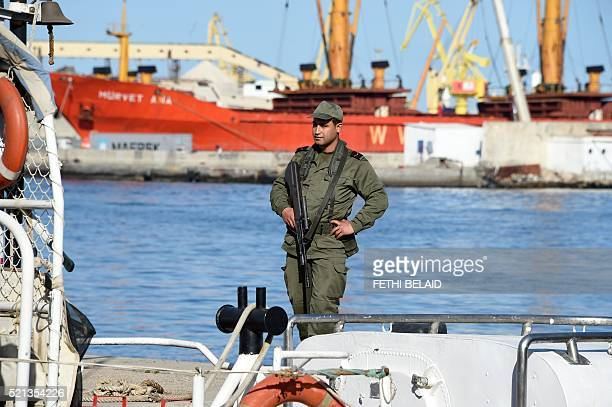 A Tunisian soldier stands guard in the port of Sfax after residents blocked access to a ferry on April 15 2016 in an attempt to prevent the police...