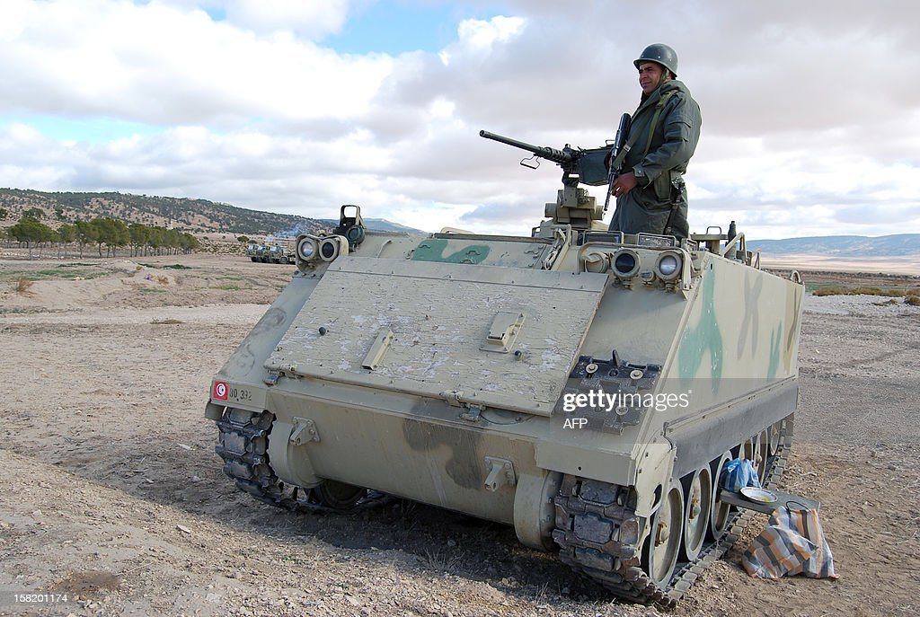 A Tunisian soldier stands on his tank as he takes part in a search operation for gunmen in Dernaya Mountains in the Kasserine region, near the Algerian border, on December 11, 2012. Tunisian security forces have mounted a search operation for gunmen who carried out an attack in the Kasserine region, killing a policeman, a security source said.